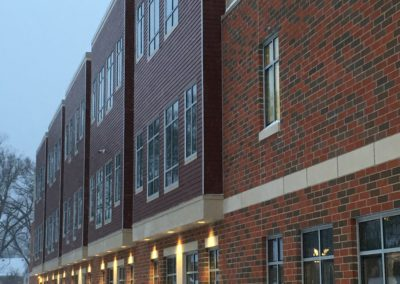 Westmont Hilltop - Elementary ~ Exterior, Classroom Facade on Winter Evening (KM)